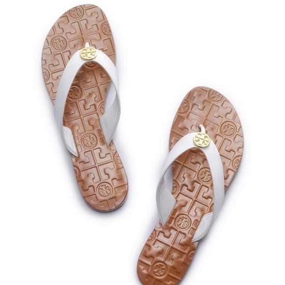 1fbed86afeba9 Tory Burch Thora White Patent Leather Flip Flops. M 5acb7b1031a37626a5b07e4a
